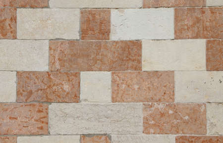 marble wall: wall of red and white marble of an ancient Palace in South Europe Stock Photo