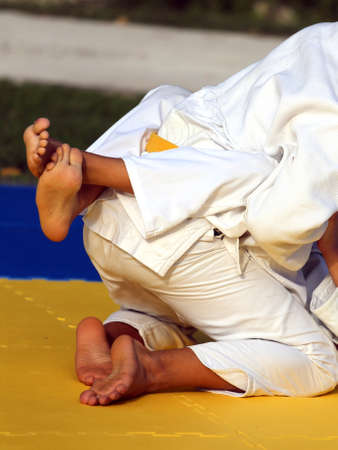 combat: martial arts combat during the sporting event Stock Photo