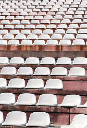 ultras: white chairs in empty stands of a modern Stadium before the sporting events