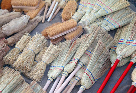 sales person: brooms and brushes of sorghum in local market Stock Photo