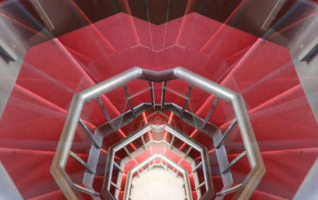 hallucination: as a hallucination of a long spiral staircase with red carpet