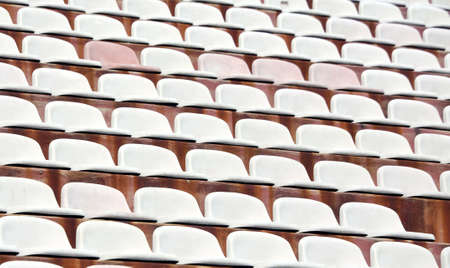 ultras: white seats in empty stands of a modern Stadium before the sporting events Stock Photo