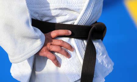 arts: Master of Karate with black belt and white kimono