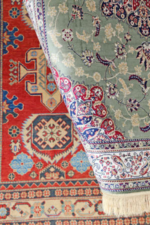 prayer rug: luxurious carpets of fine Eastern manufacturing for sale in luxury store Stock Photo