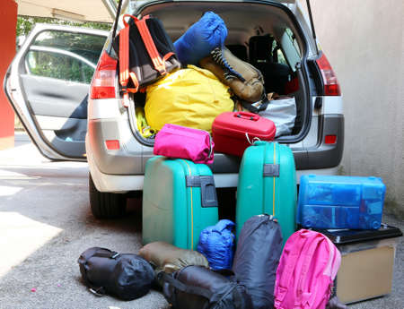 car overloaded with suitcases and duffle bag for family travel