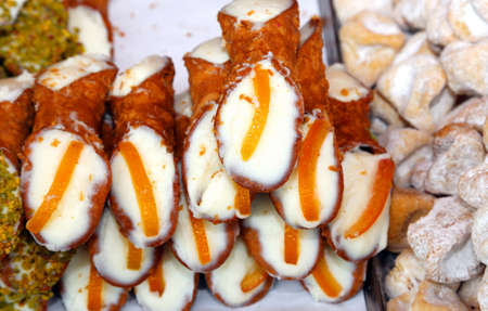 typical: typical Sicilian pastries called CANNOLI with pastry cream for sale