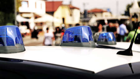patrolling: Blue sirens of police car while patrolling in the city Stock Photo