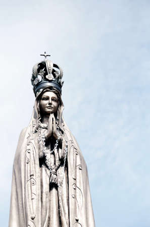 clasped hands: statue of our Lady with clasped hands and the precious Crown Stock Photo