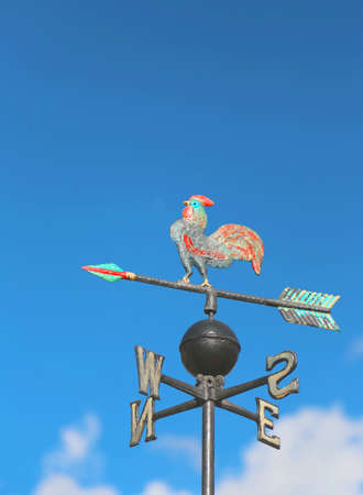 wind vane: wind vane for measuring wind direction with a big cock Stock Photo