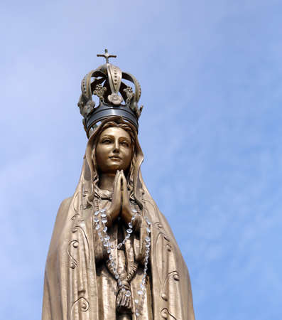 clasped hands: ancient statue of our Lady with clasped hands Stock Photo