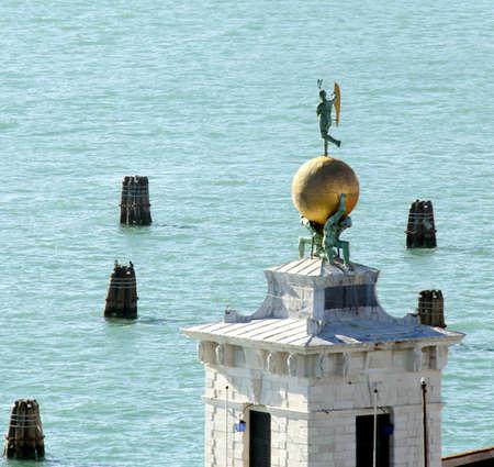 golden globe: Venice Italy famous monument called Punta della Dogana with golden globe