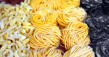 starchy food: spaghetti and noodles for sale in Italian pasta shop