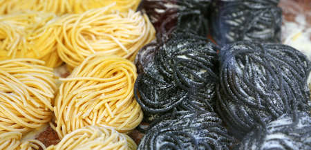 pastasciutta: spaghetti and noodles for sale in Italian pasta shop