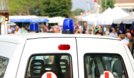 Siren of ambulances during the sporting event with many people