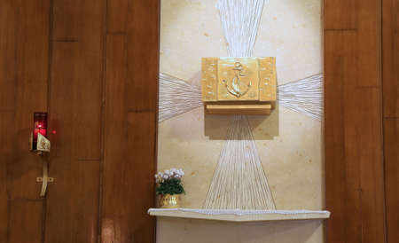 tabernacle: Golden Tabernacle and lighted candle in the Christian Church
