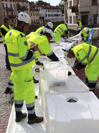rescuer: Vicenza, Italy. 10th October, 2015.  Civil Protection during International Exercise and action of Contrast to Hydraulic Emergency in Local Urban Site