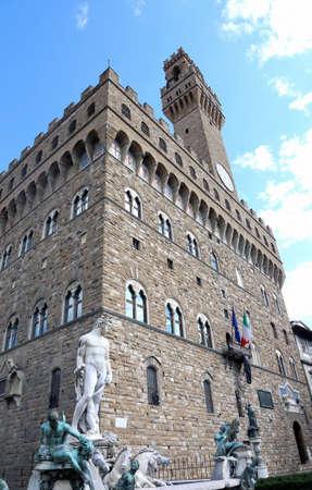 signoria square: Big statue of Neptune in the ancient fountain in Florence and Palazzo Vecchio