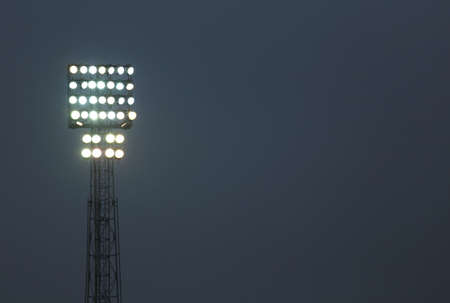 immense: immense tower floodlights with many spotlight Stock Photo