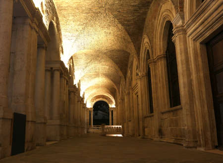 a nocturne: inside of the Palladian Basilica an historic building in Vicenza city in Italy Stock Photo