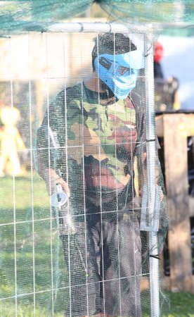 paramilitary: soldier with rifle during airsoft session or simulated war
