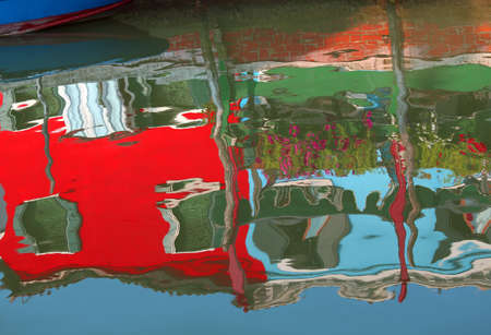 colourfully: Colourfully painted houses on Burano and reflection on the water