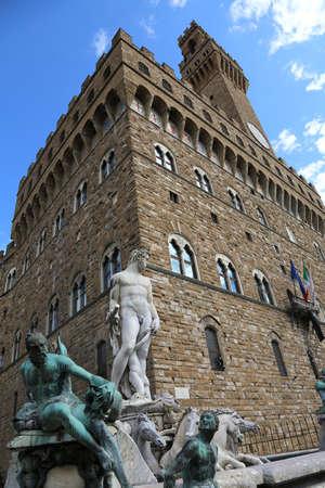 signoria square: Big White statue of Neptune in the ancient fountain in Florence and Palazzo Vecchio