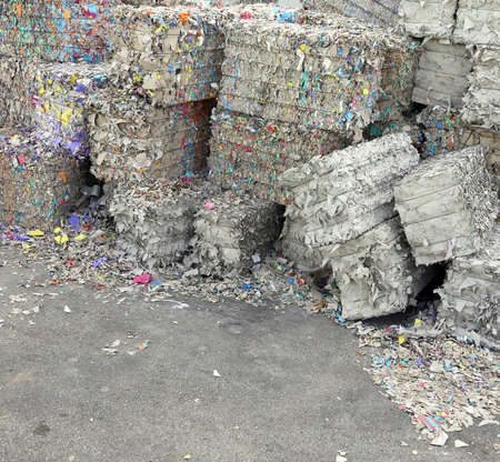 repurpose: heaps of waste paper in the paper mill Stock Photo