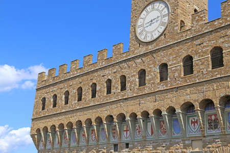 signoria square: Detail of Facade of Old Palace called Palazzo Vecchio in Florence Italy