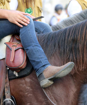 herdsman: cowboy boots relaxes over the horses back