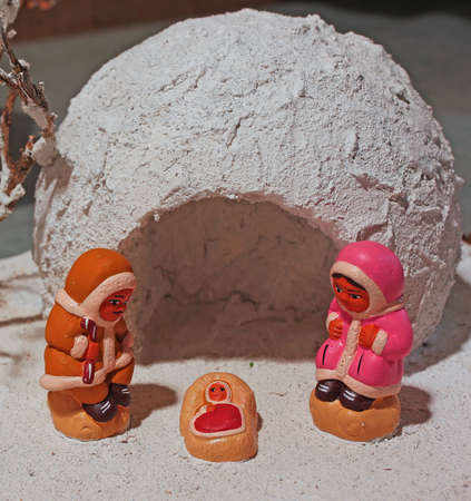 north pole: ethnic crib with the Eskimos to the north pole and a white ice igloo