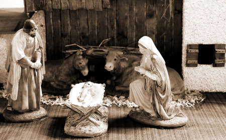 manger: classic nativity scene with baby Jesus in the manger with St Mary St Joseph and ox with donkey Stock Photo