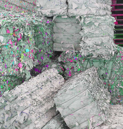 papel reciclado: heaps of waste paper in the paper mill for the production of recycled paper