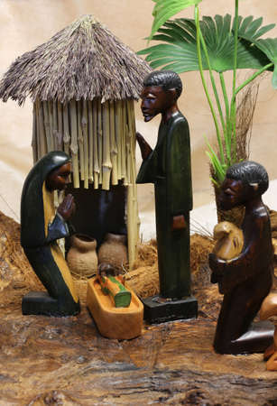 presepe: african nativity scene with baby jesus joseph and mary in a hut