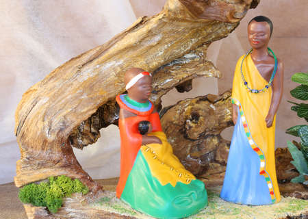 creche: crib with African hut and wooden statues of the Holy Family