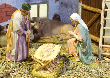 jesus statue: Neapolitan nativity scene with baby Jesus Mary and Joseph in the manger Stock Photo