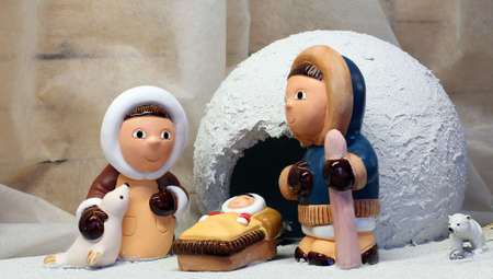 nativity set: crib with the Eskimos to the north pole and a white ice igloo
