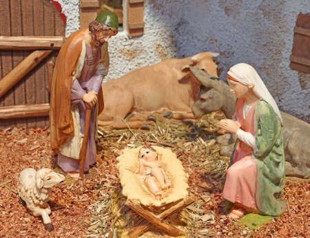 manger: classic nativity scene with baby Jesus in the manger with St Mary St Joseph and animals