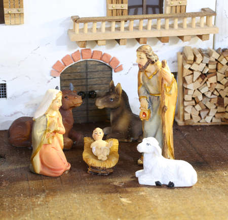 presepio: classic nativity scene with baby Jesus in the manger with St Mary St Joseph and ox with donkey and a sheep
