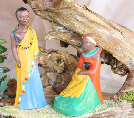 presepio: crib with African hut and statues of the Holy Family