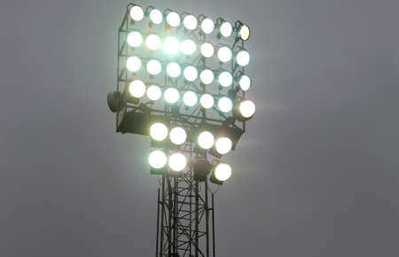 lighting system: many lights on at night during the show in the stadium Stock Photo