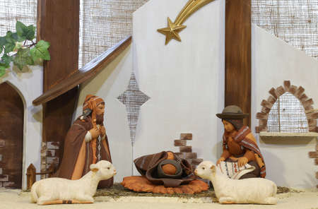 presepio: crib of South America with baby Jesus and the terracotta figurines and sheep