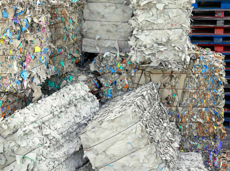 waste paper: huge piles of waste paper in the factory store