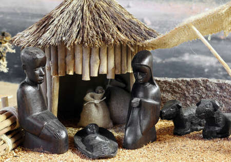 mother of jesus: african nativity scene with baby jesus joseph and mary in a hut on Christmas