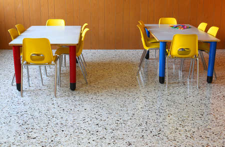 day care center: Yellow Chairs and tables in a kindergarten classroom