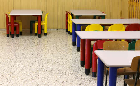 day care center: small colored tables and chairs in the refectory of the kindergarten