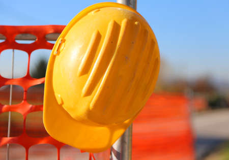 protective suit: hard hat on the road construction site during road works and a safety net