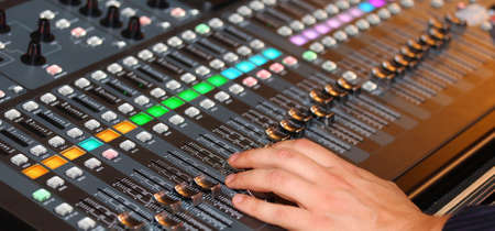 technologically: big mixing console with channel to change volume and bass and treble Stock Photo