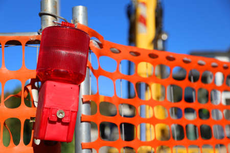 road works: signal lamp of the road works and the bulldozer
