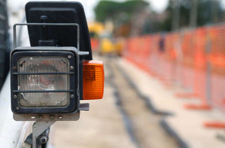 roadwork: light and turn signal of a bulldozer in the road construction site