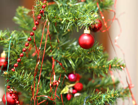 christmastide: red glass balls decorate a Christmas tree Stock Photo